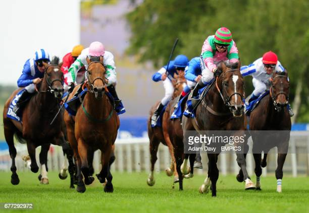 Dream Ahead ridden by Hayley Turner comes home to win the Darley July Cup