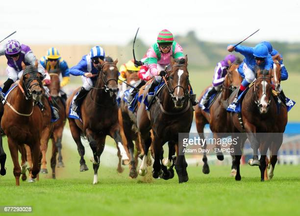 Dream Ahead ridden by Hayley Turner comes through to win the Darley July Cup