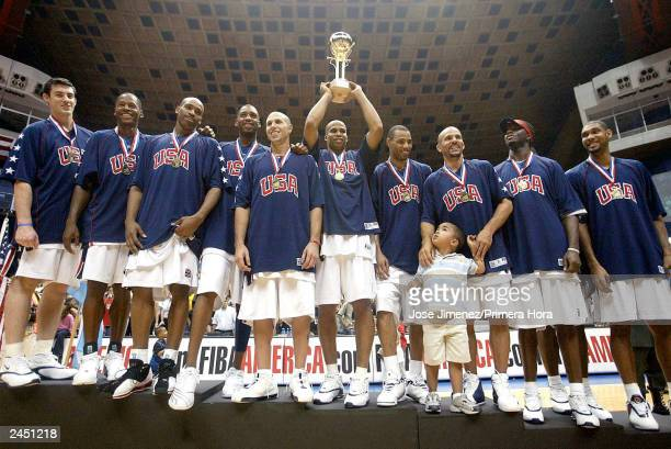 Dream Team players celebrate their gold medal after defeating Argentina 10673 during the gold Medal game of the Athens Olympic Qualifying Basketball...