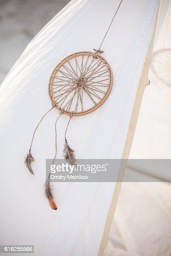 Dreamcatcher on white tent. : Stock Photo