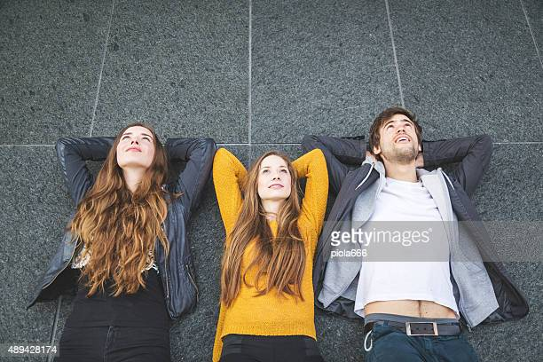 Dreamers lying down on a marble wall
