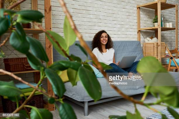 Dreamful girl with laptop