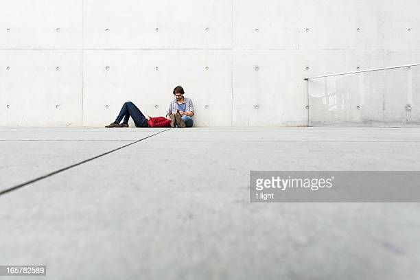 Dreaming couple at concrete wall