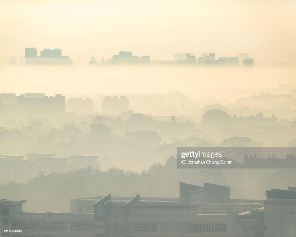 Misty morning over Singapore.