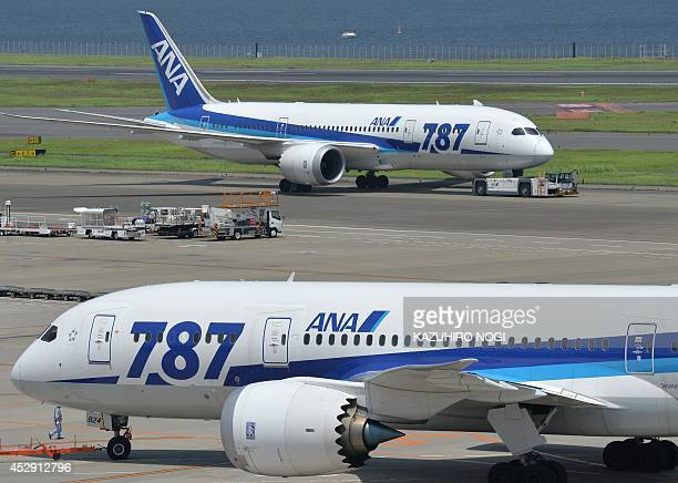 Dreamliner 787 passenger planes from Japan's All Nippon Airways are pictured on the tarmac at Tokyo's Haneda airport on July 30 2014 All Nippon...