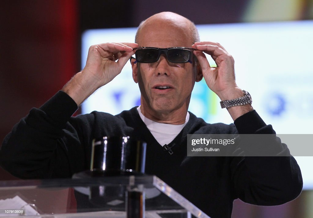Dreamworks Animation CEO <a gi-track='captionPersonalityLinkClicked' href=/galleries/search?phrase=Jeffrey+Katzenberg&family=editorial&specificpeople=171496 ng-click='$event.stopPropagation()'>Jeffrey Katzenberg</a> tries on 3D glasses as he speaks during a keynote address by Samsung President and General Manager of Visual Display Business Boo-Keun Yoon at the 2011 International Consumer Electronics Show at the Las Vegas Hilton January 6, 2011 in Las Vegas, Nevada. CES, the world's largest annual consumer technology tradeshow, runs from January 6-9 and is expected to feature 2,700 exhibitors showing off their latest products and services to about 126,000 attendees.