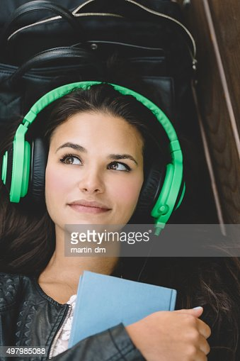 Dreamy girl with headphones : Stock Photo