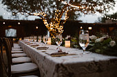 A Dreamy Outdoor Dinner Setting at dusk with bistro lights