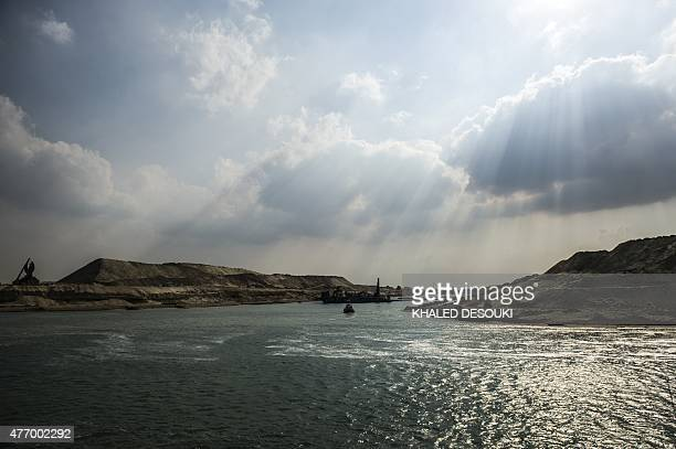 A dredger is seen at work on the new waterway of the Suez canal on June 13 in the port city of Ismailia east of the capital Cairo Egypt will...