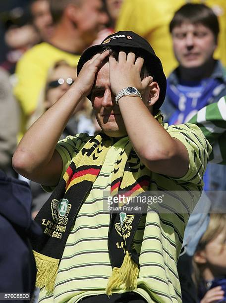 Dresden fan looks dejected during the Second Bundesliga between Hansa Rostock and Dynamo Dresden at the Ostsee Stadium on May 14 2006 in Rostock...
