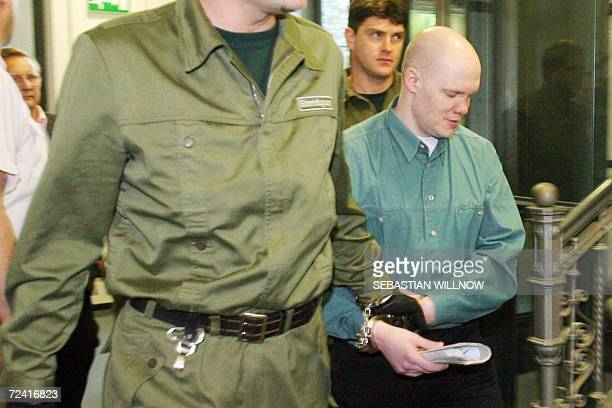 Convicted German sex offender Mario M is led to court in Dresden 06 November 2006 on the first day of his trial for kidnapping and rape Mario M...