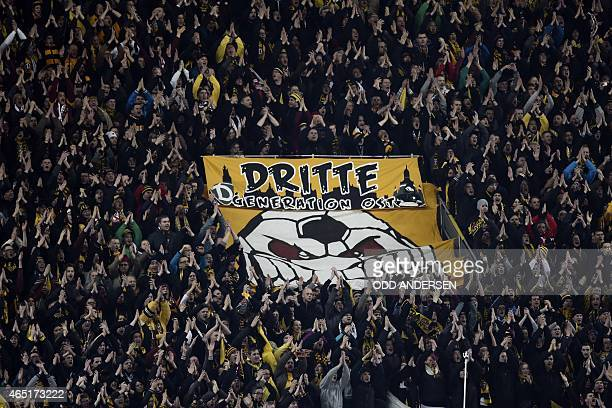 Dresden's fans wave around a giant banner reading 'Third generation East' before the start of the German football Cup DFB Pokal round of 16 game...