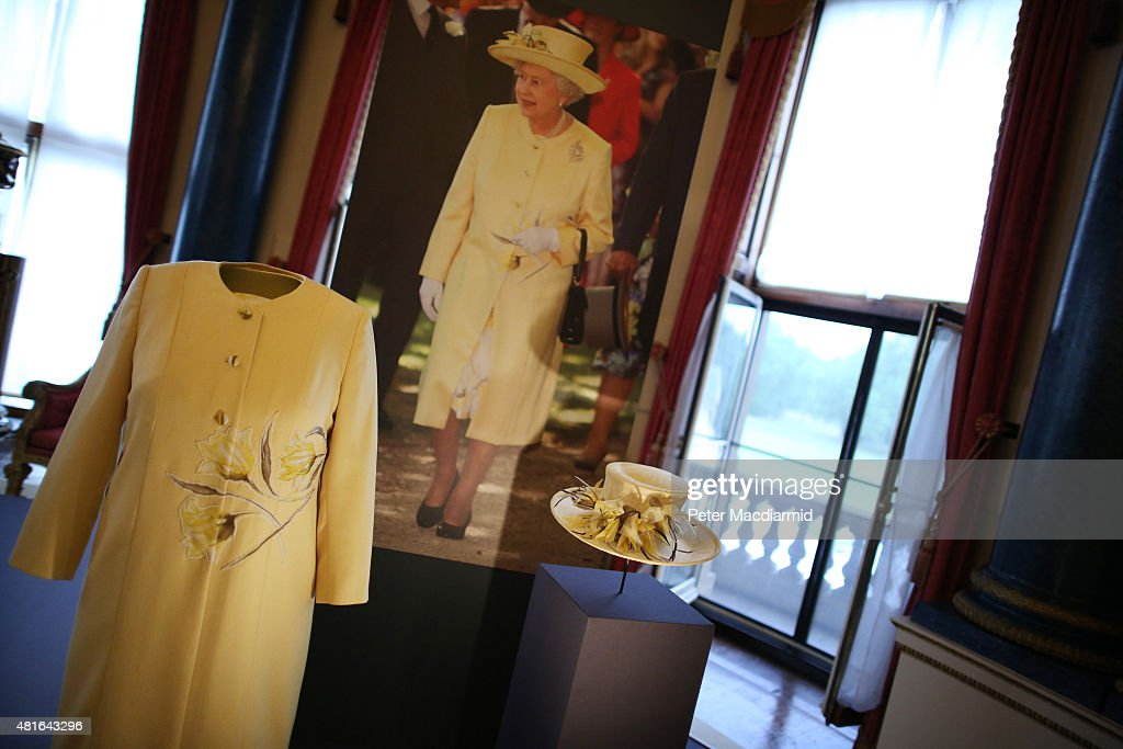 A dress and coat designed by Angela Kelly Couture and a hat by Rachel Trevor-Morgan all worn by Queen Elizabeth II for a garden party are shown at The Royal Welcome exhibition Summer opening at Buckingham Palace on July 23, 2015 in London, England. Last year the Royal Family welcomed around 62,000 guests to Buckingham Palace, at State Visits, receptions, Garden Parties, Investitures and private audiences. At the Summer Opening of the Palace, displays throughout the State Rooms have recreated the settings for some of these royal occasions, and give an insight into what goes into creating a royal welcome, from the laying of a table at a State Banquet, to the creation of an outfit worn by Her MajestyThe Queen to receive visitors.