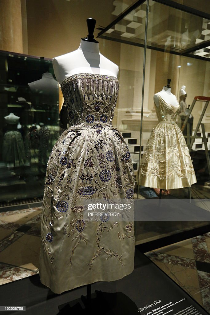 A dress by French designer Christian Dior is on display in the storage of the Galliera fashion museum in Paris on February 25, 2013. AFP PHOTO PIERRE VERDY