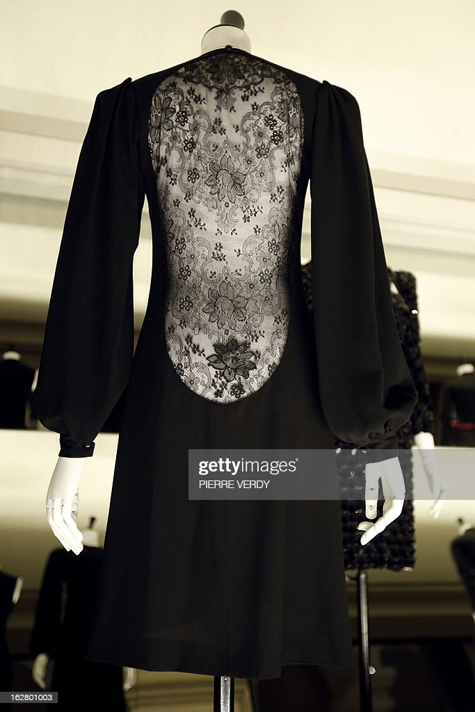 A dress by French designer Yves Saint Laurent is displayed in the storage of the Galliera fashion museum in Paris on February 25, 2013.
