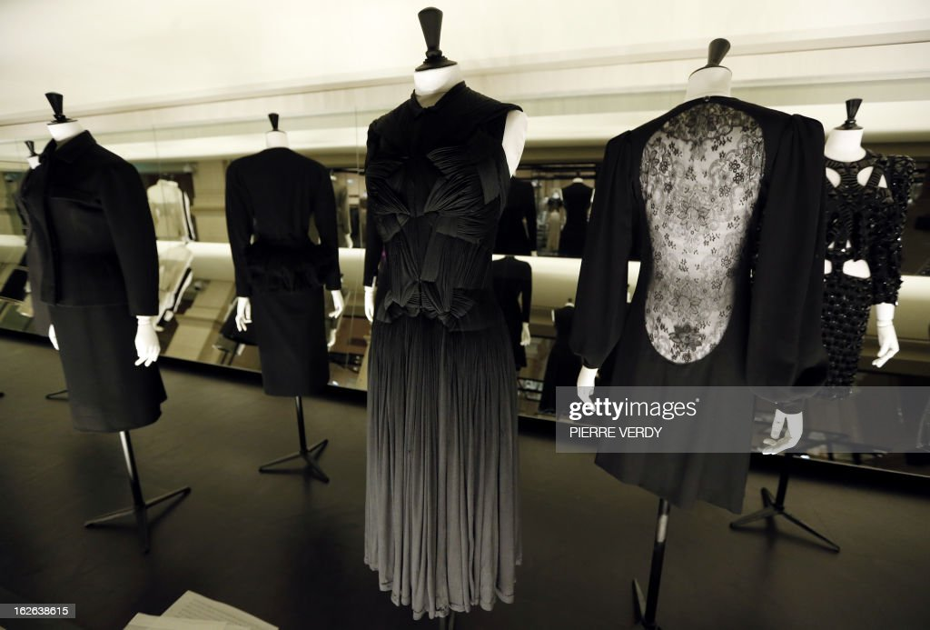 A dress by French designer Yves Saint Laurent (R) is on display in the storage of the Galliera fashion museum in Paris on February 25, 2013.