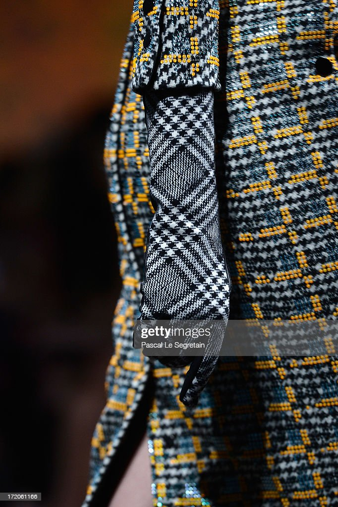 A dress detail is seen as a model walks the runway during the Christian Dior show as part of Paris Fashion Week Haute-Couture Fall/Winter 2013-2014 at Hotel Des Invalides on July 1, 2013 in Paris, France.