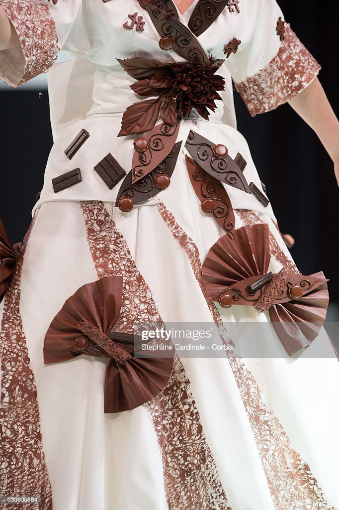 Dress detail of Actress Cecile Bois as she walks the runway, and wears a chocolate dress made by designer Jean Doucet and 'Le Chocolat de H', during the Fashion Chocolate Show at Salon du Chocolat at Porte de Versailles, in Paris.