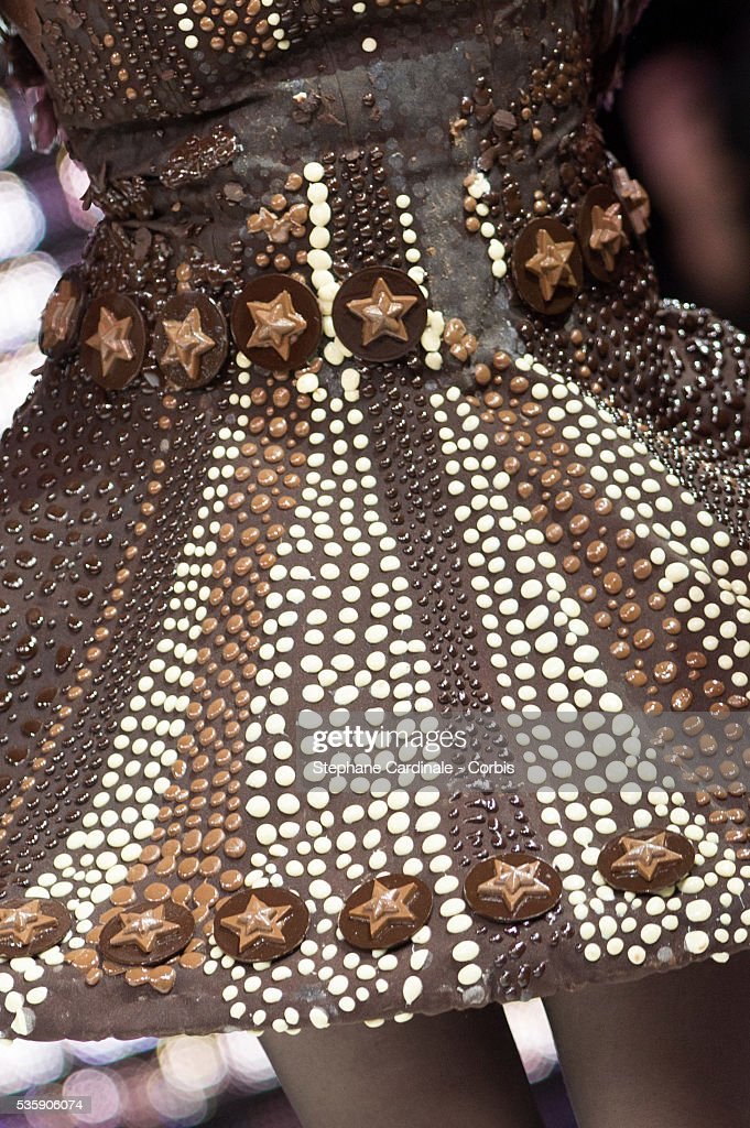 Dress detail of TV presenter Louise Ekland, as she walks the runway, and wear chocolate creation made by designer Nathalie Erkan and chocolate maker Franck Kestener, during the Fashion Chocolate Show at Salon du Chocolat at Porte de Versailles, in Paris.