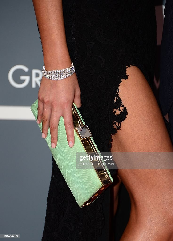 Dress detail on Chrissy Teigen as she arrives with musician John Legend on the red carpet at the Staples Center for the 55th Grammy Awards in Los Angeles, California, February 10, 2013. AFP PHOTO Frederic J. BROWN