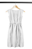White linen dress on wooden clothes rack isolated over white