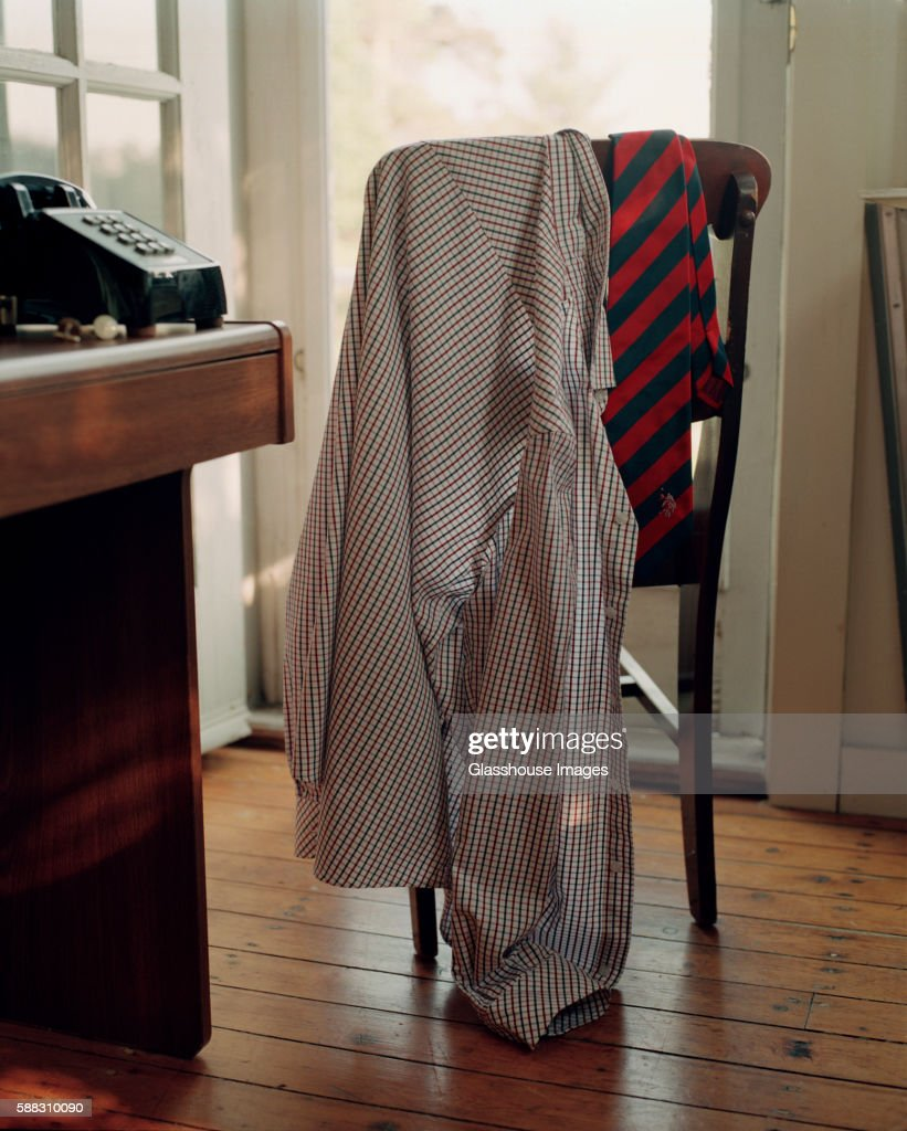 Dress Shirt and Tie hanging on Back of Chair