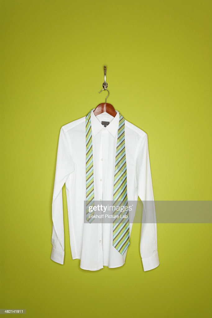 Dress shirt and tie on hanger : Stock Photo