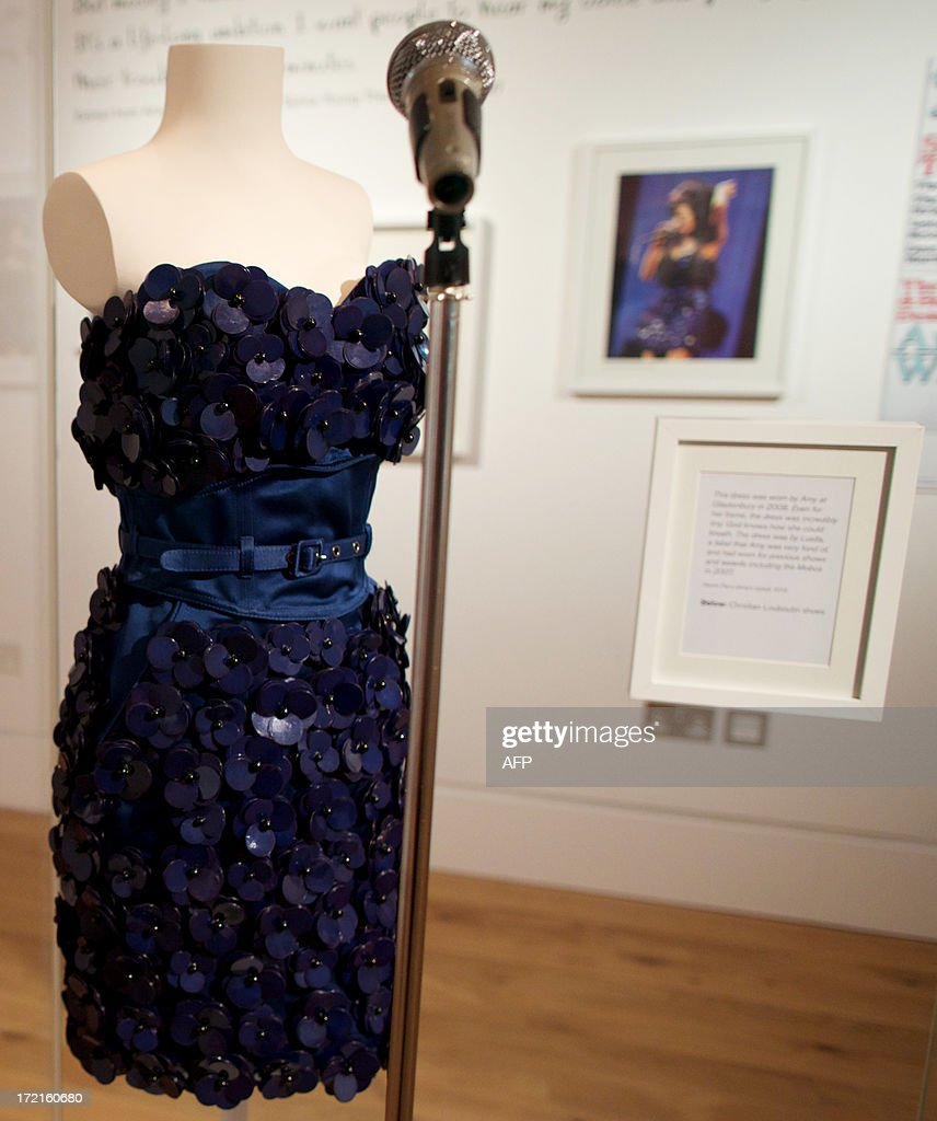 A dress worn by British singer Amy Winehouse during her performance at the Glastonbury Festival in 2008 is displayed at the 'Amy Winehouse A Family Portrait' exhibition at the Jewish Museum in North London on July 2, 2013. It is Amy Winehouse, but not as we know her. The mass of dark hair, steady gaze and full lips are instantly recognisable, but there is no hint of the scrawny, tattoed addict she would later become. Intimate family photographs, displayed for the first time in a new exhibition opening on July 3, 2013, offer a heartbreaking glimpse of the fresh-faced Jewish girl who grew up to become one of Britain most famous soul singers.