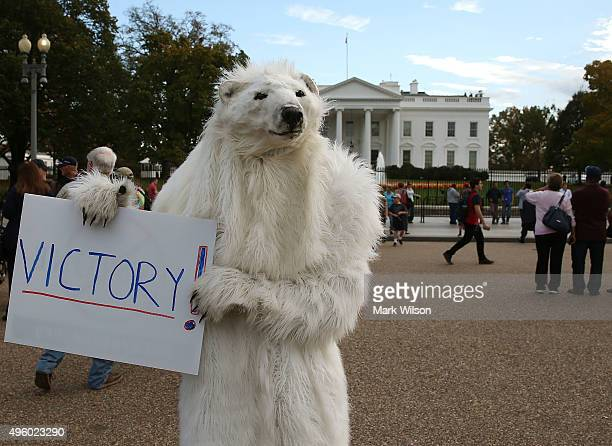 Dressed as a Polar Bear climate control activist Catherine Kilduff from the Center for Biological Diversity holds a victory sign after after...