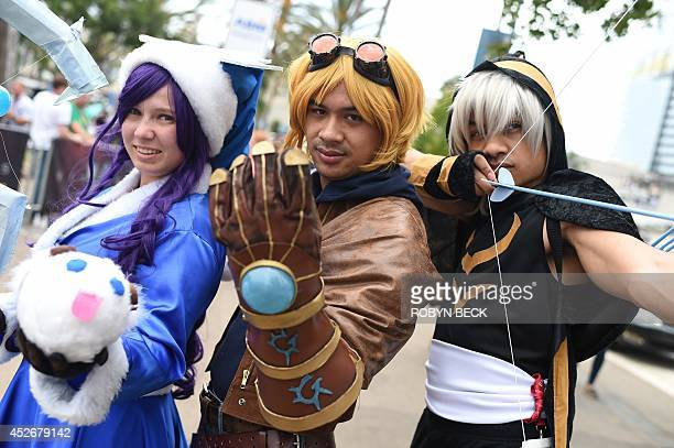 Dressed as Champions from the League of Legends online video game Melanie Delia as Lulu Justin LaTorre as Ezrela Jason Williams as Ashe pose on the...