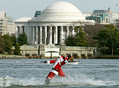 Dressed as Santa Claus Kerry Nistel waterskis on the waters of the Potomac River December 24 2007 in Arlington Virginia This is the 22nd year Nistel...