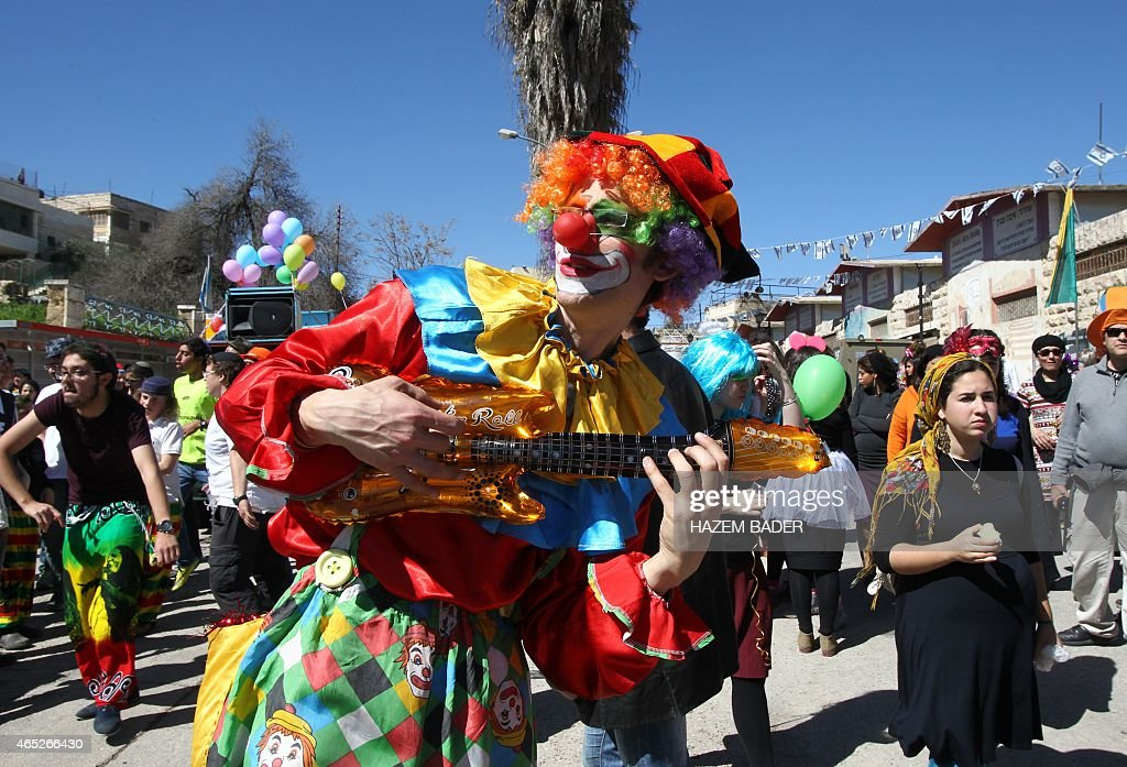 Dressed up Israeli settlers take part in a parade during the festivities of the Jewish holiday of Purim on March 5 2015 in the West Bank town of...