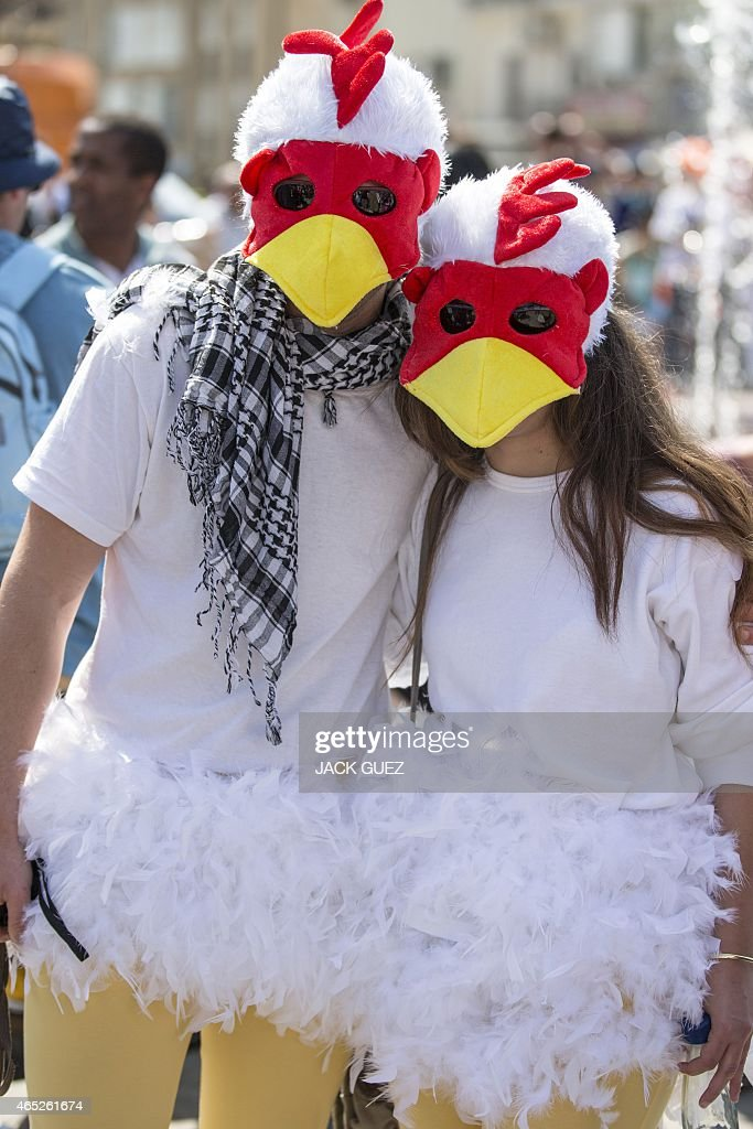 Dressed up Israelis take part in a parade during the festivities of the Jewish Purim festival on March 5 2015 in the central Israeli city of Netanya...