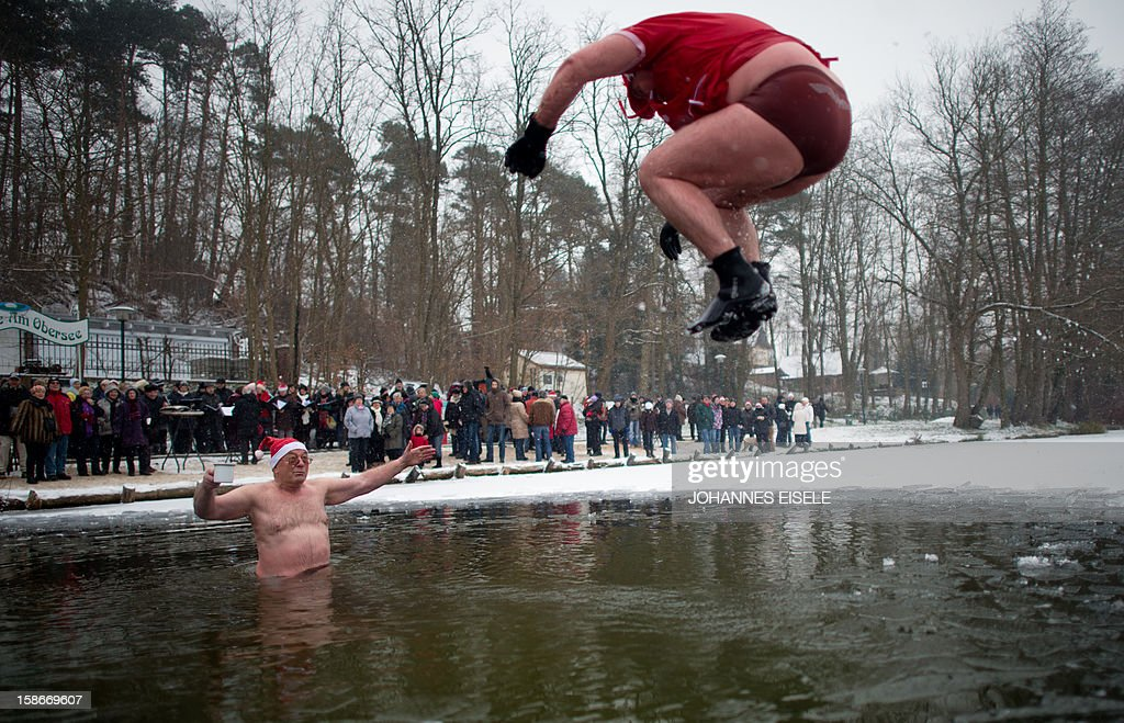 A dressed up winter swimmer jumps into the cold water during a traditional ice swimming session on December 23, 2012 in Lanke, some 50 kilometers north of Berlin.
