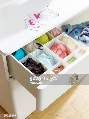 Dresser with underwear, cards and eyeglasses. : Stock Photo