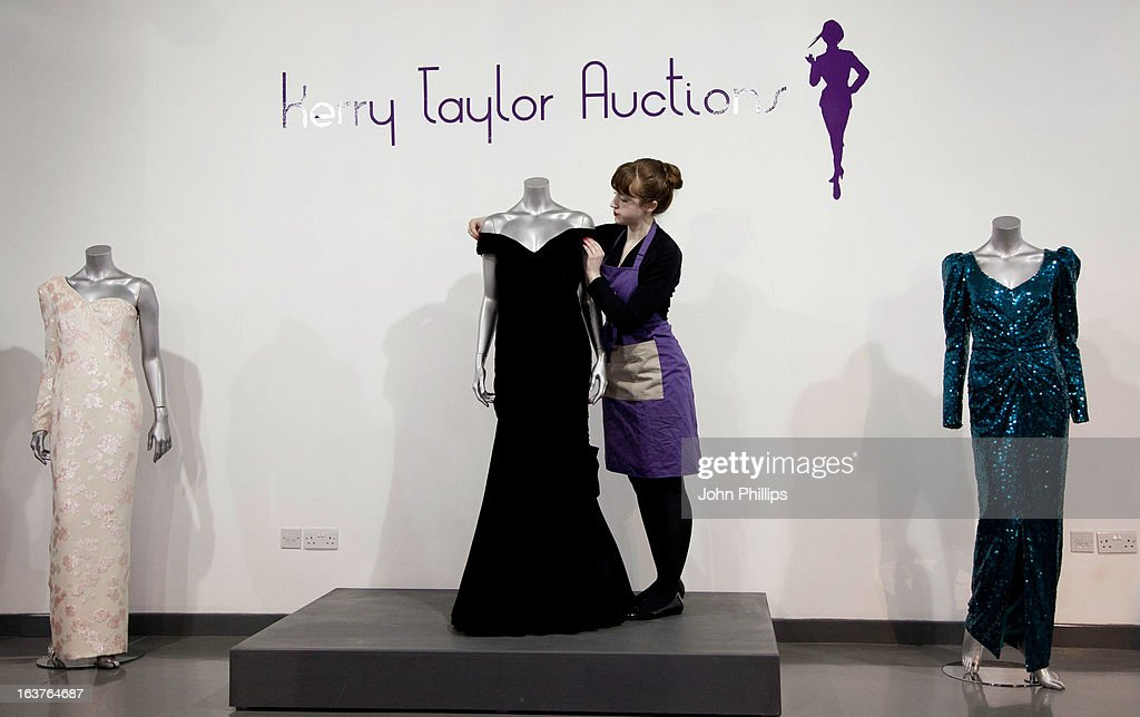 Dresses are displayed at a photocall ahead of the the 'Fit For a Princess' auction on March 15, 2013 in London, England. Ten dresses from the collection of Diana, Princess of Wales are to be auctioned by specialist Kerry Taylor.