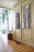 Dresses hanging from closet door