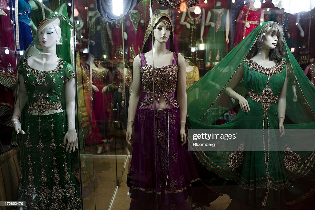 Dresses made in India are displayed for sale at a store inside Noor Shopping Center in Kabul, Afghanistan, Wednesday, Aug. 7, 2013. A smooth U.S. exit from Afghanistan will depend on Pakistans cooperation with the logistical pullout, as well as its backing for peace talks in neighboring Afghanistan and an end to any support for extremist proxies operating there. Photographer: Victor J. Blue/Bloomberg via Getty Images
