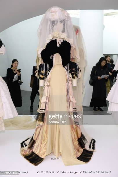 Dresses on display during 'Rei Kawakubo/Comme des Garcons Art Of The InBetween' Costume Institute Gala press preview at Metropolitan Museum of Art on...