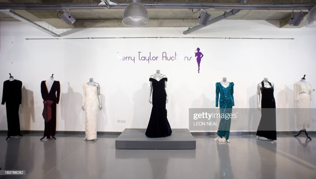 Dresses worn by Britain's Princess Diana (L-R) a Victor Edelstein evening gown worn for private entertaining in 1985, a Catherine Walker evening gown worn during a State Visit to Australia in 1985, a Catherine Walker pink sequined ivory crepe gown worn during a visit to Brazil in 1991, a Victor Edelstein evening gown worn for the State Dinner at the White House in 1985, a Catherine Walker evening gown worn for a State Visit to Austria in 1989, a Catherine Walker evening gown worn for a Vanity Fair photo-shoot with Mario Testino in 1997 and a Zandra Rhodes cocktail dress worn by Britain's Princess Diana to the Birthright benefit concert in 1987 are displayed at Kerry Taylor Auction house in south London on March 15, 2013 ahead of a sale of ten dresses that belonged to the Princess.
