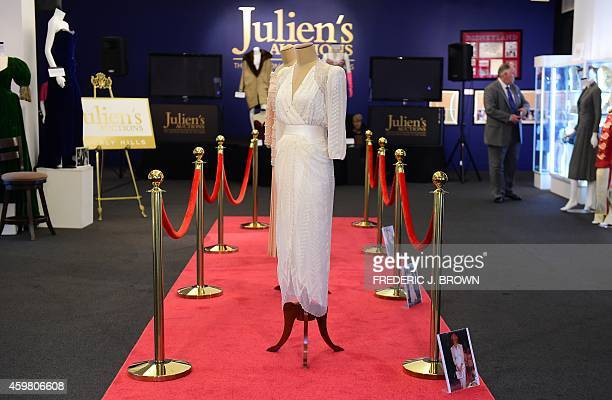 Dresses worn by the late Princess Diana four on a red carpet and one beside her poster are displayed at Julien's Auction House in Beverly HIlls...