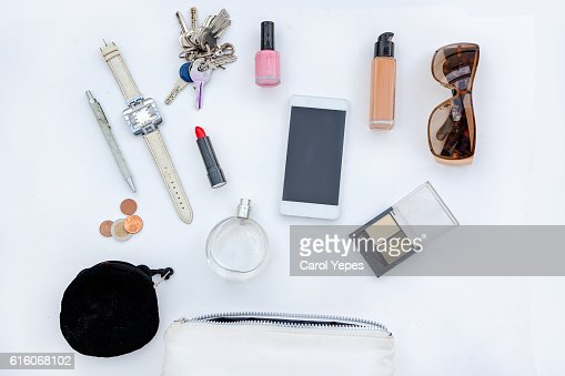 Dressing case with a lot of feminine objects.