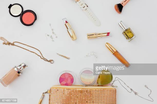 Dressing case with a lot of feminine objects.overhead shot.White background