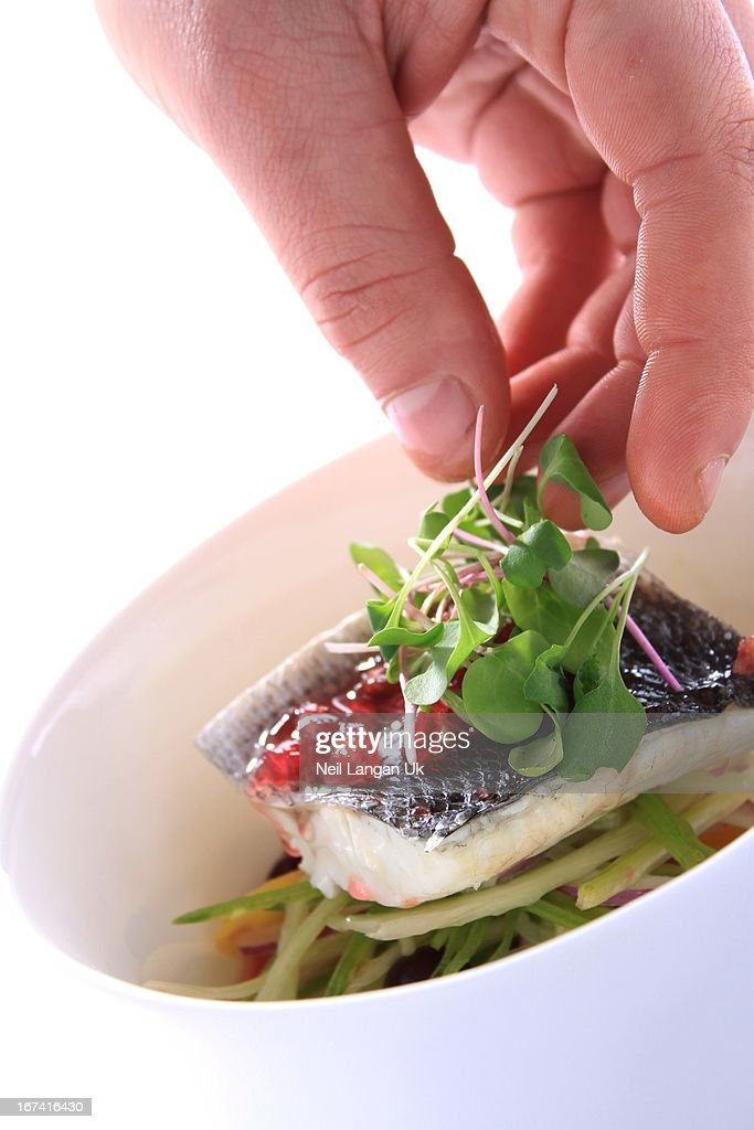 dressing fish in bowl with water cress : Stock Photo
