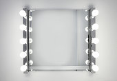 Dressing room mirror lit by ten light bulbs
