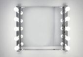 Dressing room mirror lit by ten light bulbs
