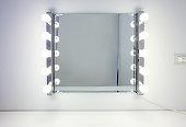 Dressing room mirror with ten light bulbs