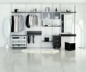 Dressing room with open wardrobe in white color tone.