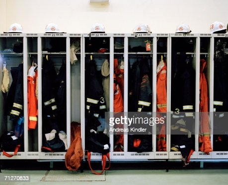 A dressingroom with clothes for a fire brigade.