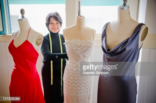 dressmaker in her shop : Stock Photo